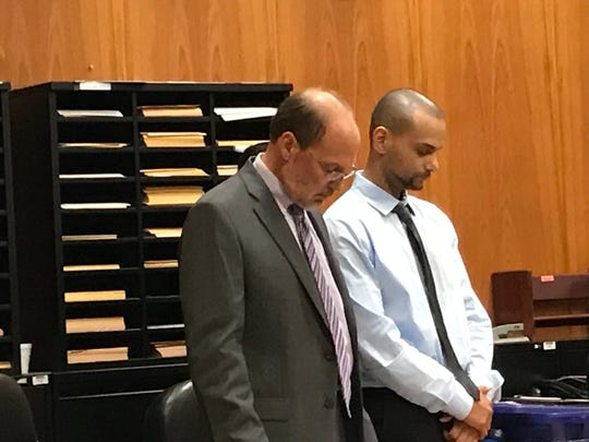 Damien Edwards ( R ), with his attorney, Paul Condon, as the jury announces its verdict.
