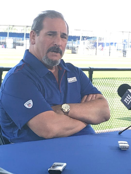 Giants general manager Dave Gettleman talks to reporters prior to the team's second practice of training camp Friday in East Rutherford.