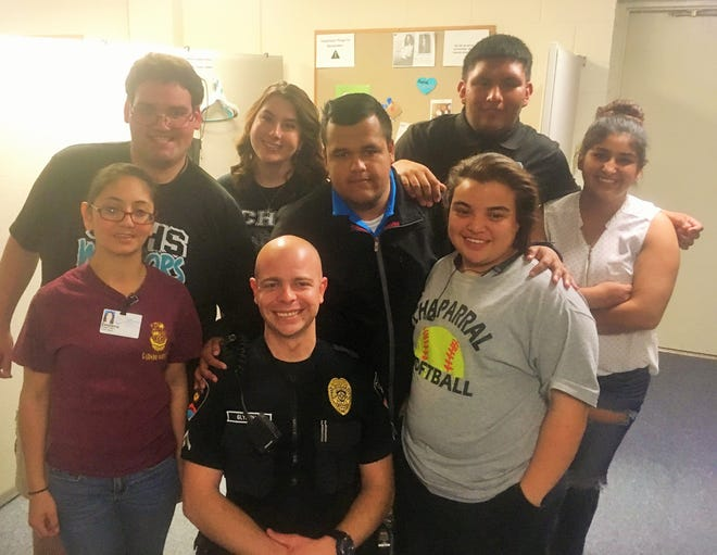 Officer Aaron Glymph from the Las Cruces Police Department gave a presentation to interns from Project SEARCH.