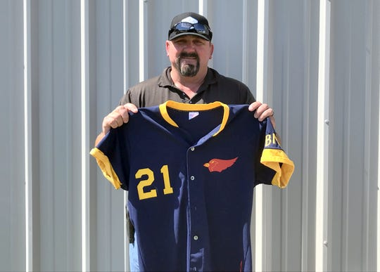 Former MLB player Shane Andrews poses with his Farmington Cardinals jersey. Andrews played in two Connie Mack World Series tournaments in the late 80's and still fondly remembers pitching against Manny Ramirez.