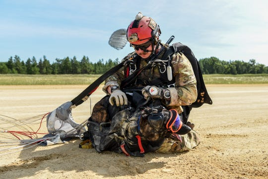 Master Sgt. Rudy Parsons, pararescueman for the 123rd Special Tactics Squadron, and Callie, his search and rescue K-9, land at Fort McCoy, Wis. July 17, 2019, as part of an domestic operations exercise. Callie is currently the only search and rescue dog in the Department of Defense.
