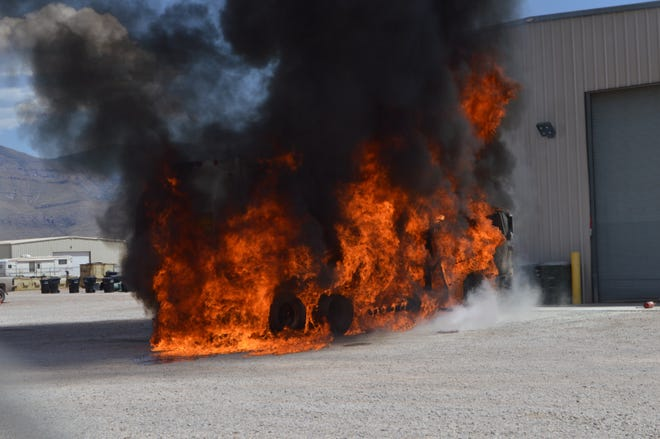 A fire consumes a truck at Southwest Disposal Friday afternoon, July 26.