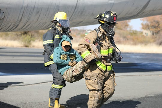 Firefighters with the Botswana Defense Force and the North Carolina National Guard work together to put out a fire and rescue victims from an airplane during a training exercise at Thebephatshwa Air Base in Botswana on July 17, 2019. The exercise was part of a two day culminating event after more than 170 Army and Air Guardsmen from North Carolina, Alabama, and New Jersey trained in partnership with their Botswana Defense Force counterparts during Upward Minuteman 2019, a U.S. Africa Command exercise promoting the U.S. National Guard's State Partnership Programs on the African Continent.