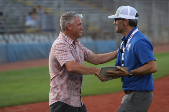 Steve Gates, the nephew of Original Seven member Doc Jones, accepts a Connie Mack World Series Hall of Fame induction plaque on Jones' behalf Thursday at Ricketts Park in Farmington.