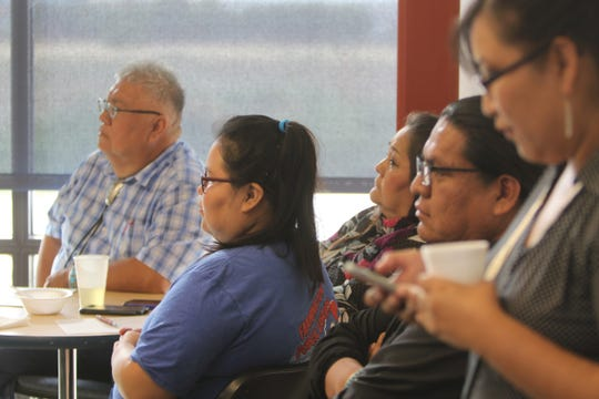 Participants listen to presentations during the public forum organized by the Native American Democratic Caucus of New Mexico on July 25 at Diné College's south campus in Shiprock.