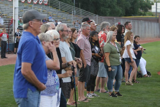 Family members of the Original Seven accept the group's Connie Mack World Series Hall of Fame induction on its behalf Thursday at Ricketts Park in Farmington.