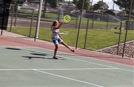 Karly Eidenschink, 11, plays tennis, Friday, July 26, 2019, at Brookside Park.