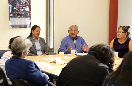 New Mexico State Rep. Anthony Allison, right, talks during the Native American Democratic Caucus of New Mexico public forum on July 25 at Diné College's south campus in Shiprock.