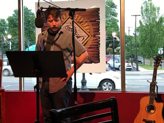Patrick Karickhoff at the poetry reading July 20 at Third Monk Brewing marking the 50th anniversary of the moon landing.