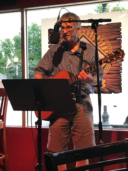 Edward Diehl at the poetry reading July 20 at Third Monk Brewing marking the 50th anniversary of the moon landing.
