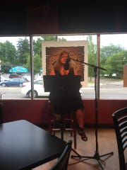 Josie Kearns at the poetry reading July 20 at Third Monk Brewing marking the 50th anniversary of the moon landing.