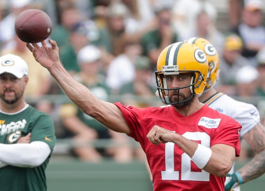 Quarterback Aaron Rodgers (12) releases a pass during Green Bay Packers training camp at Ray Nitschke Field Friday, July 26, 2019, in Green Bay, Wis.