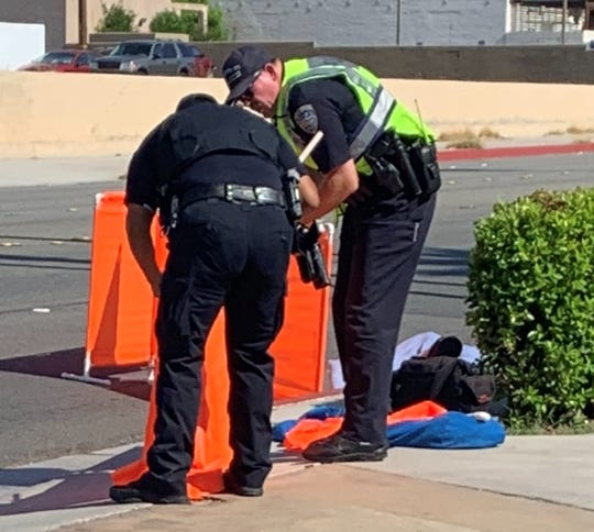 Police examine the crash scene on North Indian Canyon Drive outside the 7 Springs Inn & Suites. A pedestrian was struck there by a SunLine bus on Friday morning, July 26, 2019.