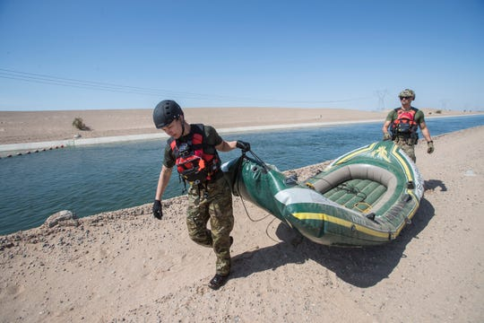U.S. Border Patrol agents Francisco Perez and Kelly Sheppard, remove a raft used by migrants to cross the All-American Canal during a demonstration for media on how rescues are performed. The agents belong to the El Centro sector of Customs and Border Protection and to the Border Patrol Search Trauma and Rescue team (BORSTAR).