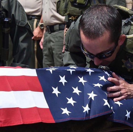Windy's handler, Deputy Robert Ochoa, says farewell.