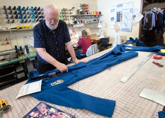 Sam Miller works on a new Blue Angels suit on Thursday. Miller, 81, has made hundreds of flights suits for the Blue Angels at his West Pensacola shop since 1987.