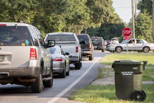 Heavy traffic makes its way through the intersection of Glover Lane and Hamilton Bridge Road in Milton on Thursday.