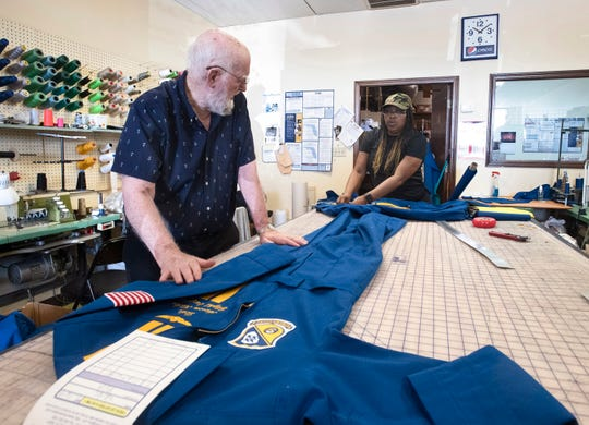 Sam Miller and Candy Whitehurst work on flight suits for new members of the Blue Angels on Thursday. Miller, 81, has made hundreds of flights suits for the Blue Angels at his Pensacola shop, now called Jellie B The Sewing Box.