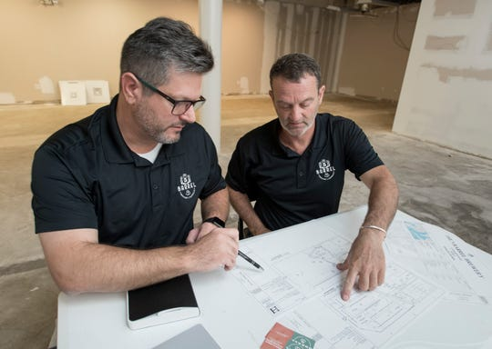 From left, Jason Mosley and Tom Akin, co-founders of The 5 Barrel, talk Friday about their plans for the new brewery in downtown Pensacola.