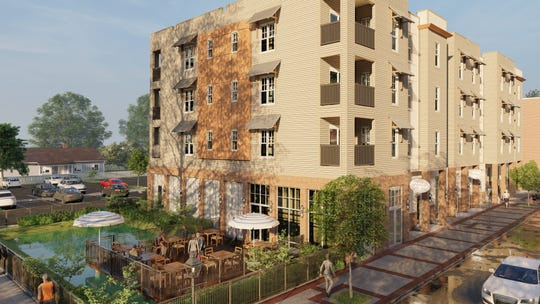 A conceptual rendering shows what the new Belmont-DeVilliers apartment building could look like.