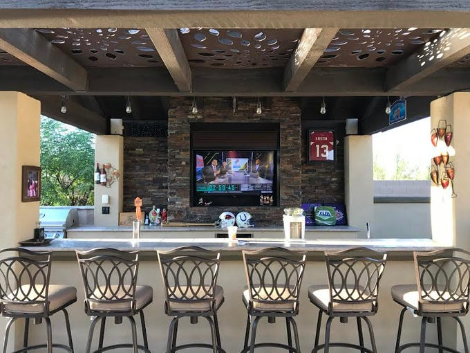George and Tamara Fiscus added an outdoor sports bar less than a year after purchasing their Mesa home in 2011.