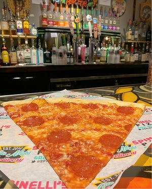A slice of pepperoni pizza from Spinelli's Pizzeria. The pizzeria will offer $1 slices of cheese and pepperoni pizza on Thursday, Aug. 1.