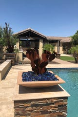 These cactus leaf-inspired fixtures coordinate with the other metal details throughout the outdoor space.