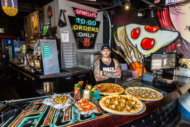 Christopher Palma, owner of Spinelli's Pizzeria, stands behind the bar at the restaurant. The Mill Avenue pizza spot opened in 2014.