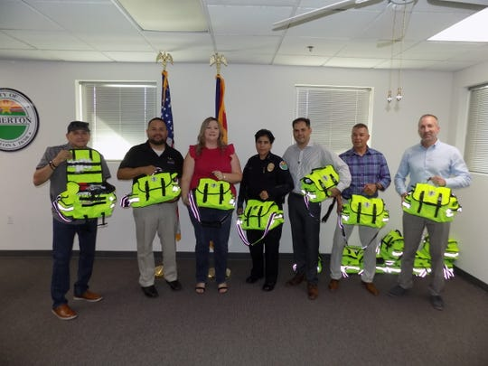 Somerton Police Chief, Aricelli Juarez, and Vice Mayor Martha Garcia stand with other community leaders and event sponsor with the donated medical bags.