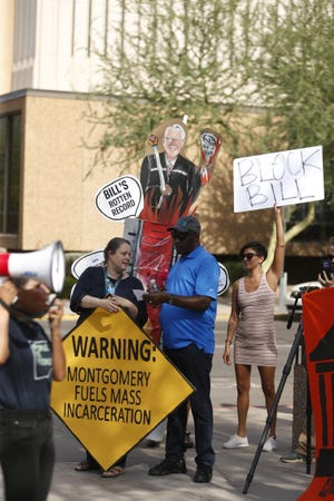 People gather during a protest against Maricopa County Attorney Bill Montgomery in Phoenix, Ariz., on July 25, 2019.