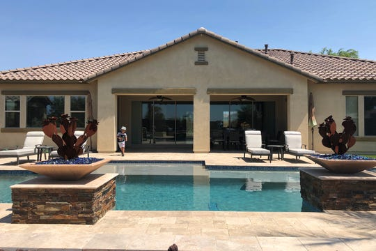 The 20,000-gallon pool is the same width as the frame for the back sliding glass doors so as you enter the house through the front door, all you see is the pool.