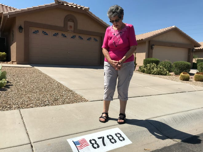 Donna Cordero, 82, of Peoria is fighting the Westbrook Village Homeowner's Association's order to paint over the American flag displayed on her curb.