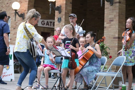 The Maechners, who are originally from Berea, spent a week's vacation in the peaceful Lakeside Chautauqua community and took the opportunity to provide some wholesome live music for those passing by.