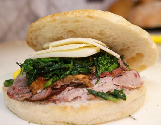 A roast pork and broccoli rabe sandwich at Rossi & Sons Rosticceria in the City of Poughkeepsie on July 24, 2019.