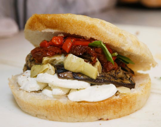 A Mediterranean sandwich at Rossi & Sons Rosticceria in the City of Poughkeepsie on July 24, 2019. The Mediterranean is made with grilled eggplant, sun-dried tomatoes, artichokes, fresh mozzarella and roasted red peppers.