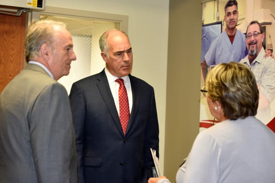 Sen. Bob Casey, D-Pa., speaks with Teresa Napier, director of patient services at Chambersburg Hospital, and Pat O'Donnell, president and CEO of WellSpan-Summit Health, and executive vice president of WellSpan Health, inside the Cath Lab waiting room at Chambersburg Hospital on July 26, 2019. The U.S. lawmaker was in Franklin County to discuss health care in rural communities.