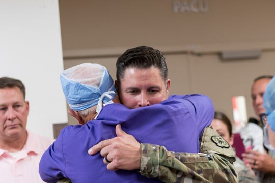 Mitch Hammond, father of Lizzy, hugs a doctor at Renown, during the organ walk on July 19, 2019.