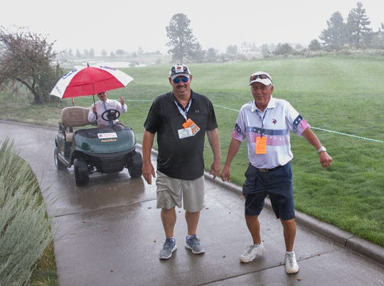 Fans walk in the rain during during the Barracuda Championship PGA golf tournament at Montrêux Golf and Country Club in Reno on Friday.