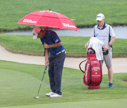 Padraig Harrington lines up a putt in the rain during the Barracuda Championship PGA golf tournament at Montrêux Golf and Country Club in Reno on Friday
