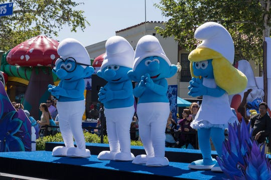 """The Smurfs arrive at the World Premiere of """"Smurfs: The Lost Village"""" at the Arclight Culver City on Saturday, April 1, 2017, in Culver City, Calif. Or it's the new receiving corps at Buffalo Bills training camp. 'I'd say with all our wide receivers, they're like Smurfs,'' said coach Sean McDermott, whose roster has seven receivers 5-foot-11 or under, and four 5-9 or under."""