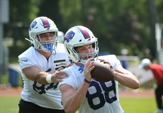 Bills tight end Dawson Knox catches a pass during training camp.