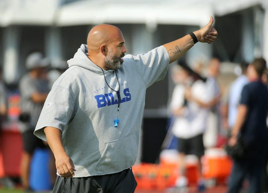 Bills offensive line coach Bobby Johnson gets his players into drills during training camp at St. John Fisher College.