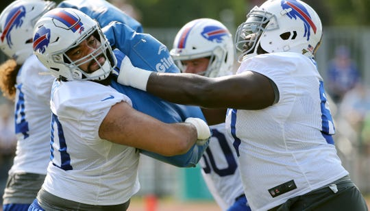 Bills rookie offensive lineman Cody Ford (left) works with Quinton Spain during training camp.