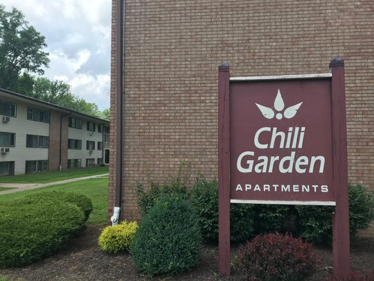 Sheriff's deputies helped residents escape after an early-morning kitchen fire at the Chili Garden Apartments complex Friday.