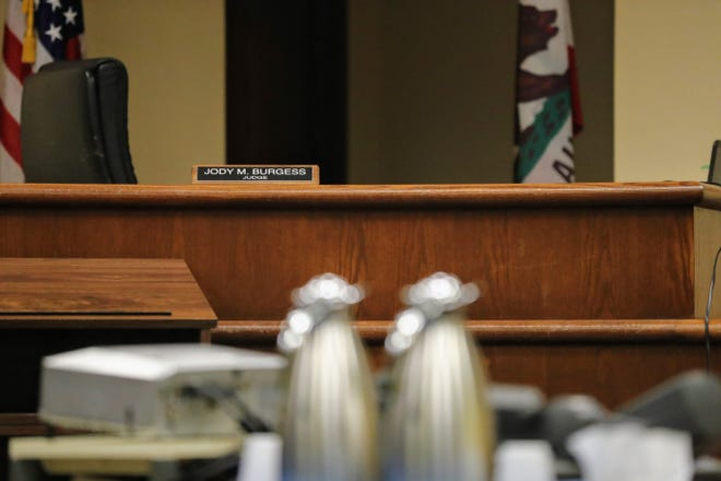 An arraignment was held Friday, July 26, for Theodore Loos, the Shasta County public defender accused of attacking his family with a splitting maul. A judge ordered photos not to be taken of Loos at the hearing.