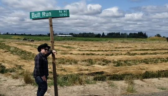 "In this screen capture from his video, Glenn Titus, a general manager at Mount Angel Meat Company, stars in their music video ""Bull Run Road, "" a parody of rapper Lil Nas X's ""Old Town Road."""