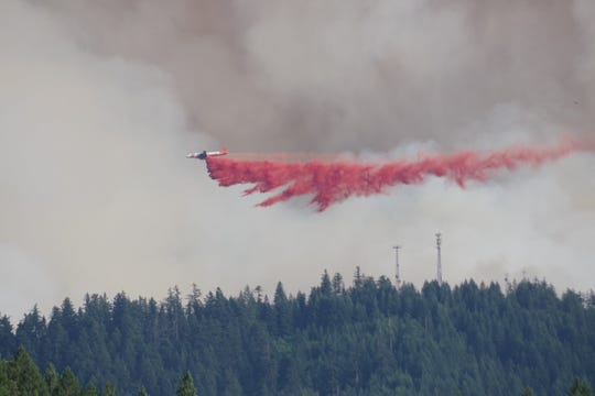An air unit drops fire retardant gel over the Milepost 97 Fire on Thursday, July 25.