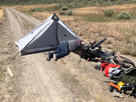 This July 18, 2019, photo provided by Tomas Quinones shows Gregory Randolph, a 73-year-old man who was stranded in the remote Oregon high desert. The 73-year-old man who was stranded in the remote Oregon high desert for four days with his two dogs was rescued when a long-distance mountain biker discovered him near death on a dirt road,  July 25.