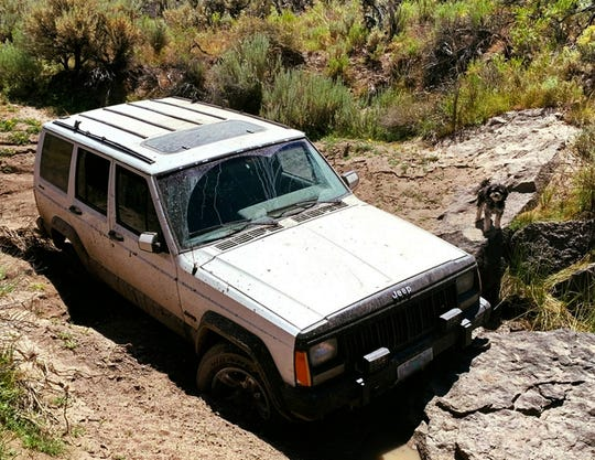 This undated photo provided by the Oregon State Police shows a jeep and dog belonging to a 73-year-old man who was found by a mountain biker on July 18, 2019.
