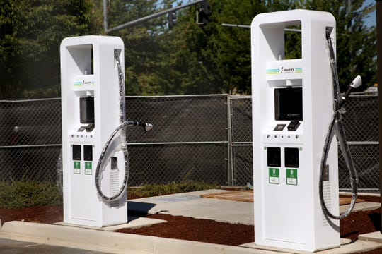 An electric vehicle charging station is being installed at the Walmart on Lancaster Dr. NE in Salem on July 26, 2019.